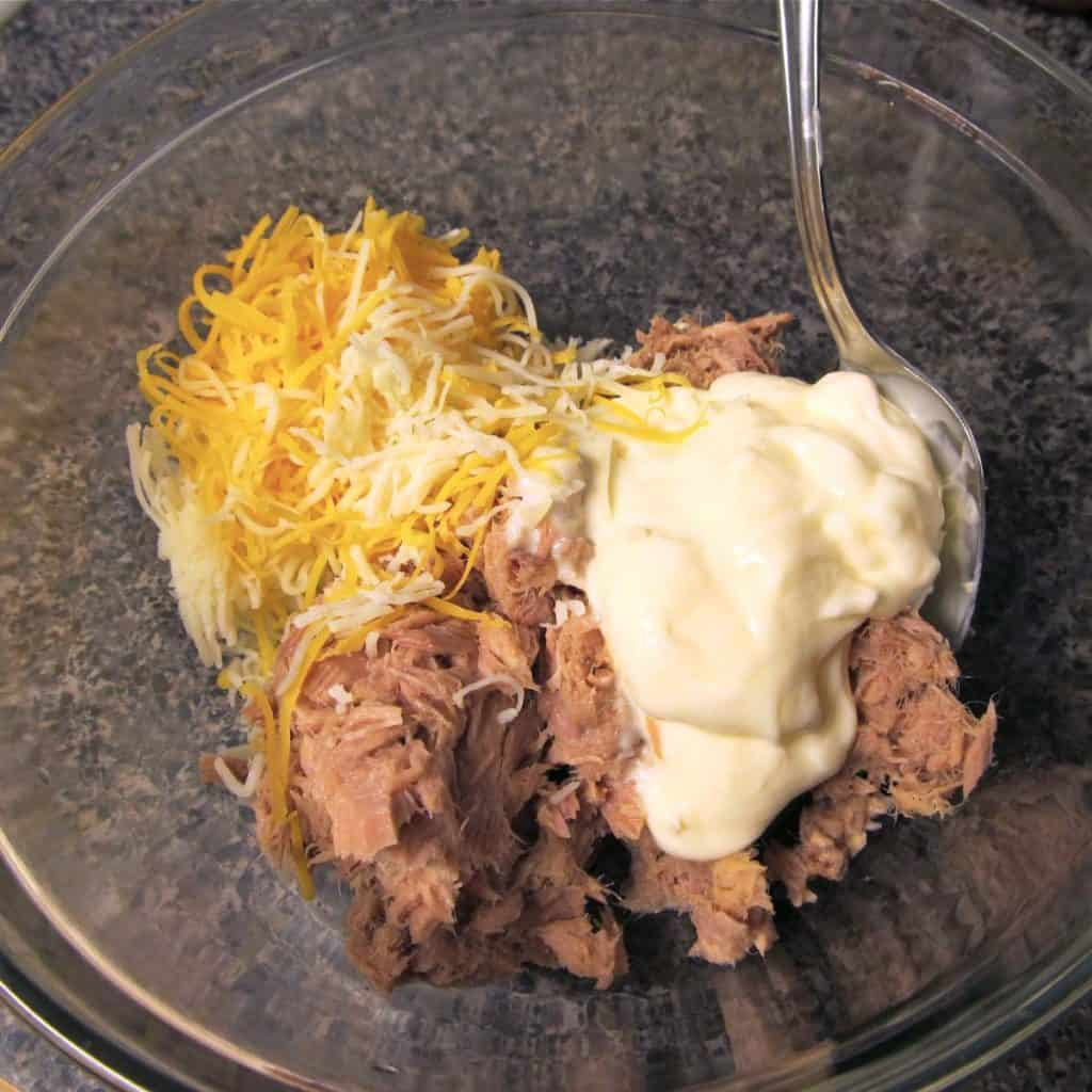 Tuna, mayo, and cheese in a bowl.