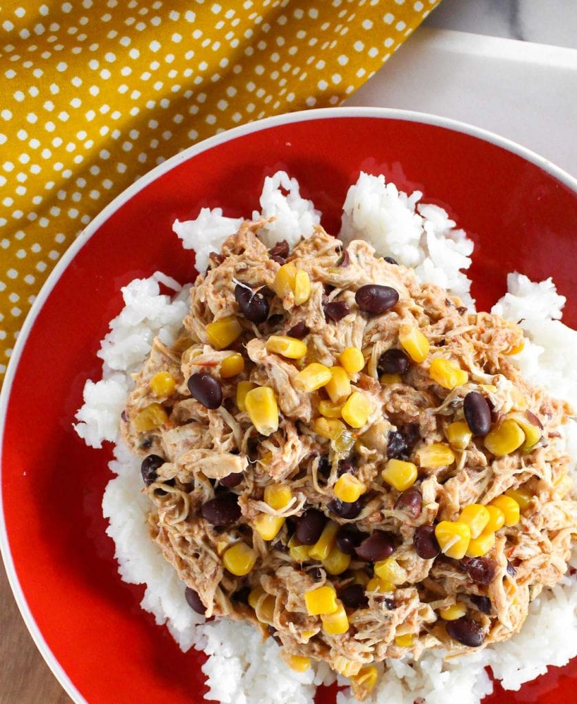 Shredded chicken with black beans and corn served over rice.