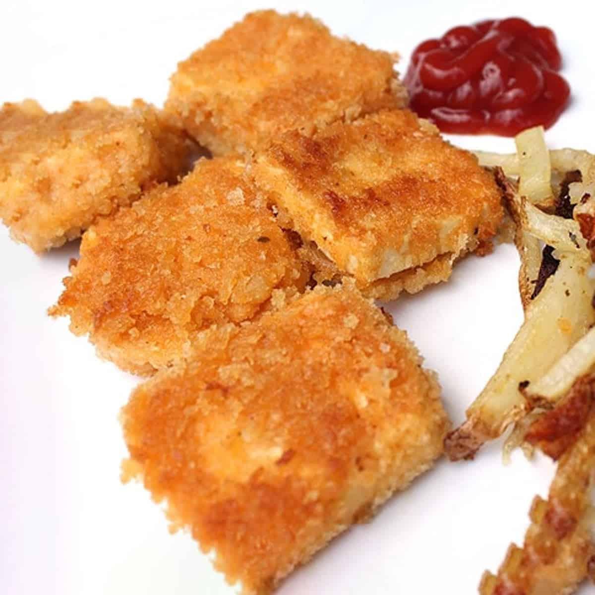 Panko Fried Tofu Nuggets with ketchup.