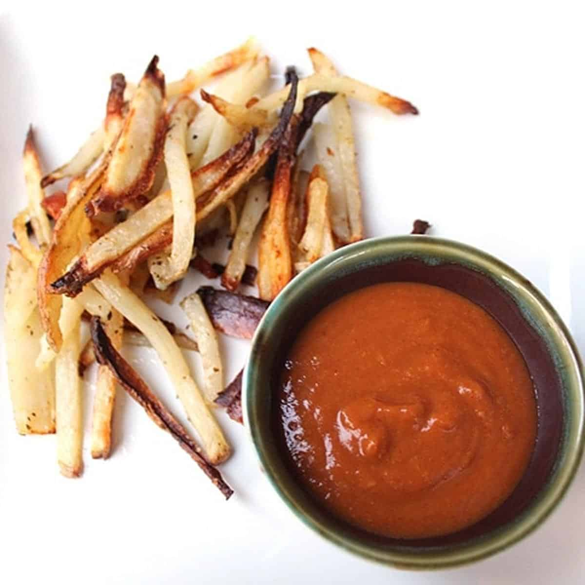 Spicy Peanut Butter Dipping Sauce with french fries.