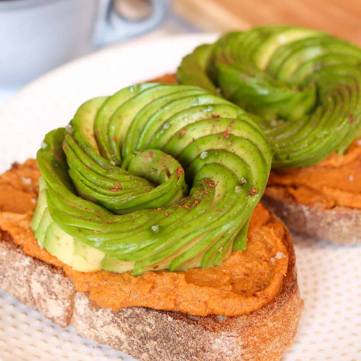 Toast topped with pumpkin and avocado.