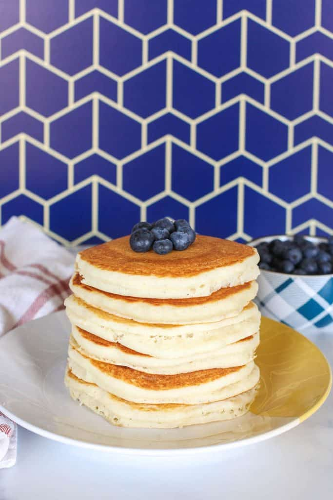 Stack of vegan Bisquick pancakes topped with blueberries.