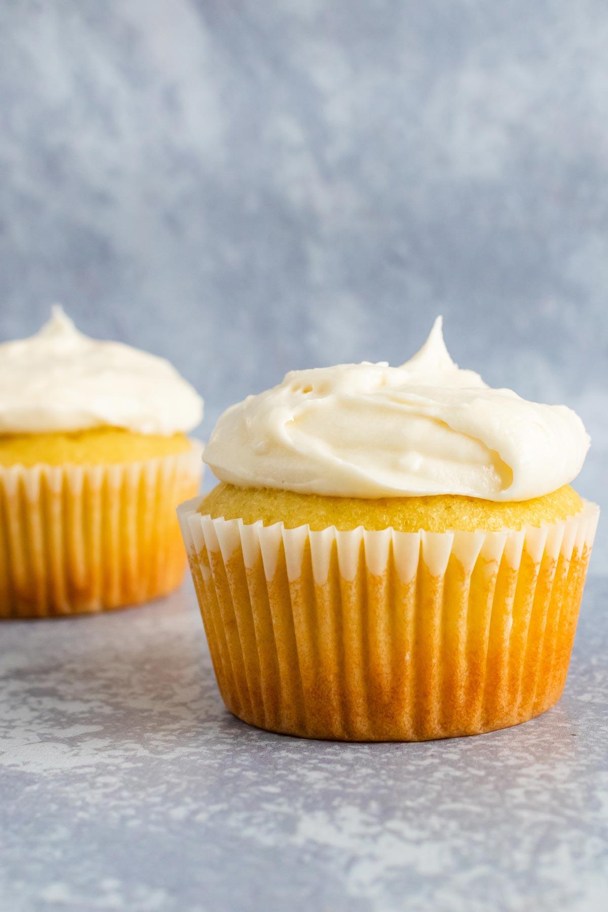 A vanilla cupcake topped with vanilla icing.