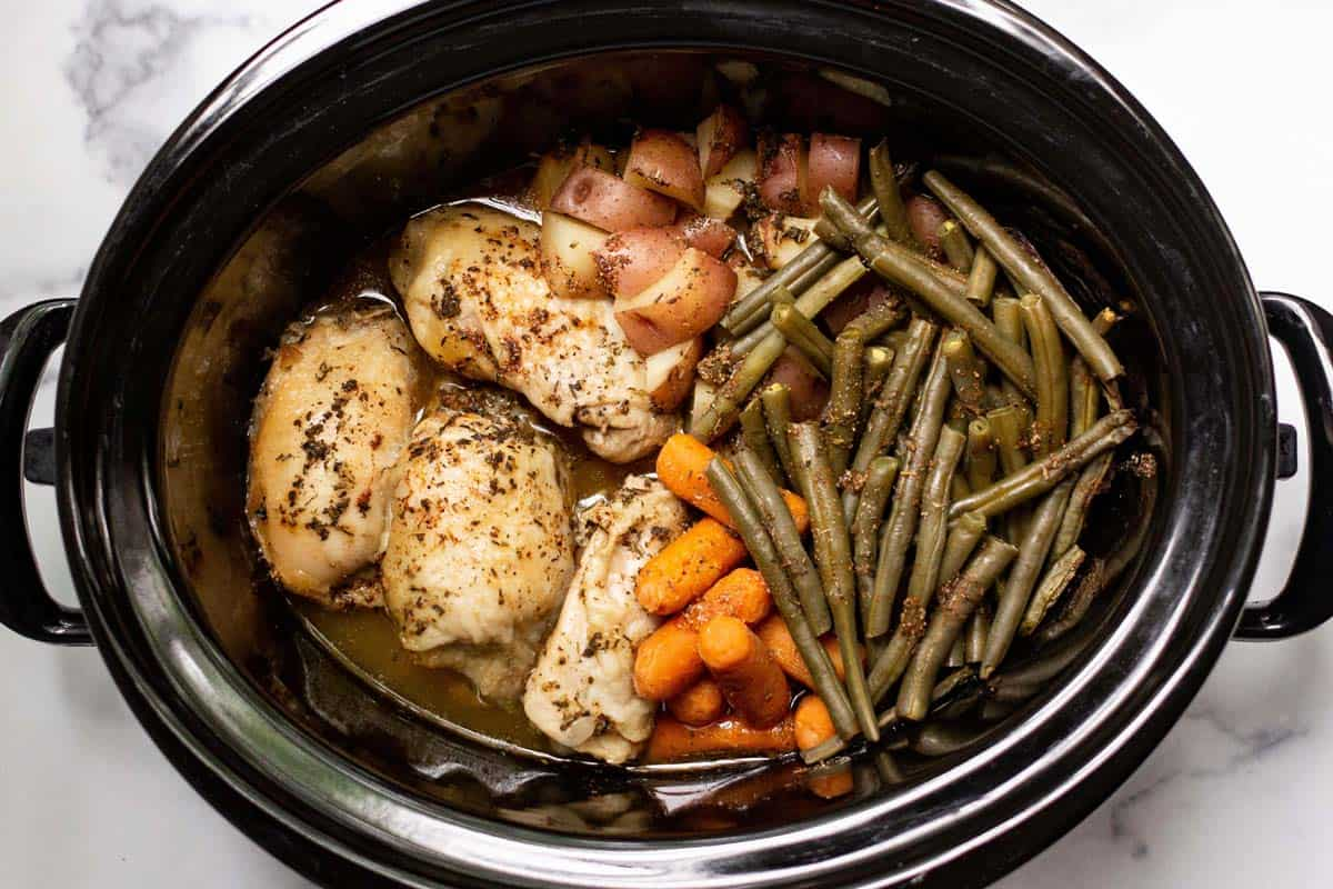 Cooked chicken and veggies in the slow cooker.