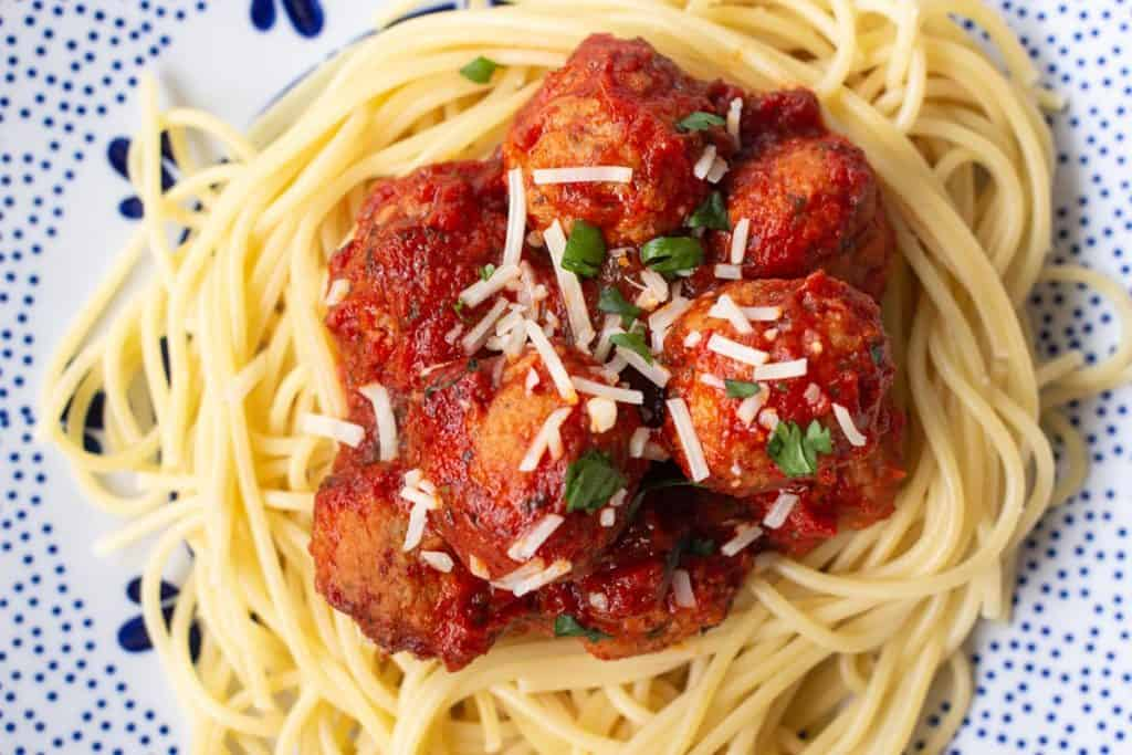 Italian meatballs on a bed of spaghetti noodles.