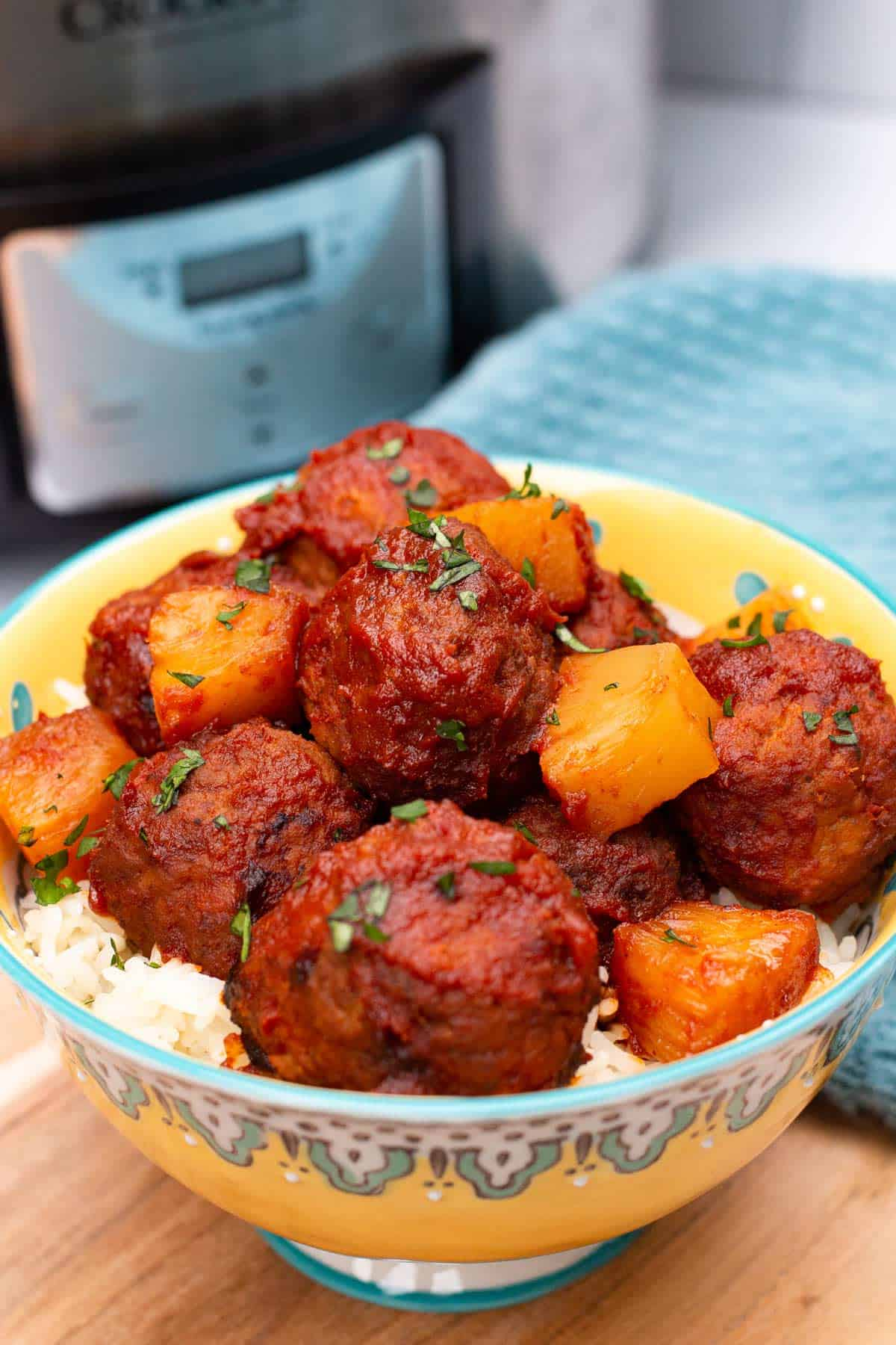 Hawaiian Meatballs in a bowl with an Instant Pot.