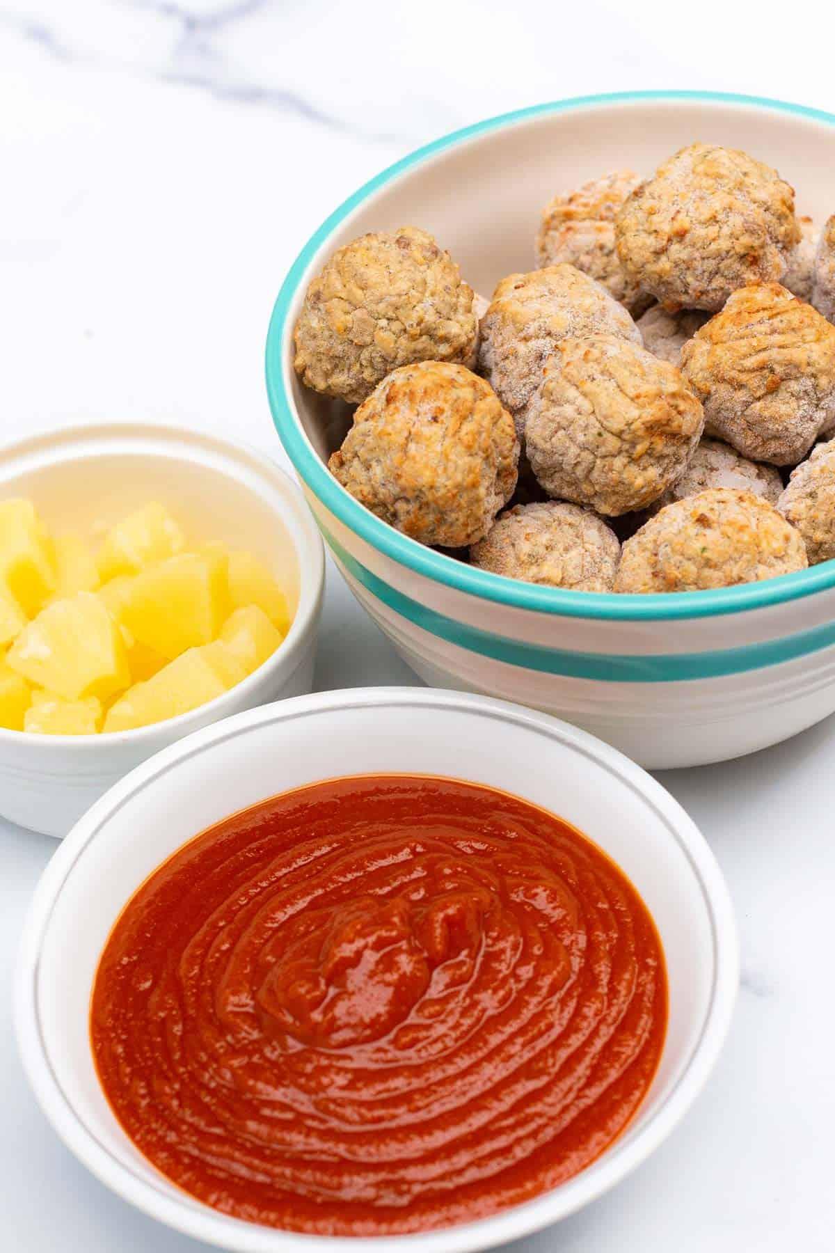 Frozen meatballs, sloppy joe sauce, and pineapple chunks.