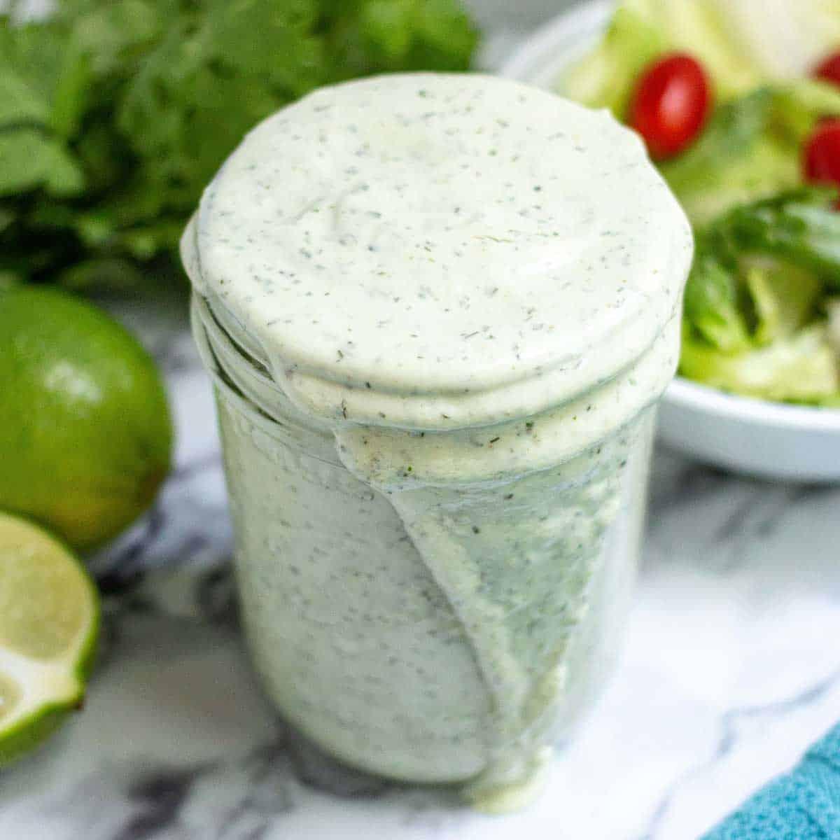 Avocado lime ranch dressing in a small mason jar.