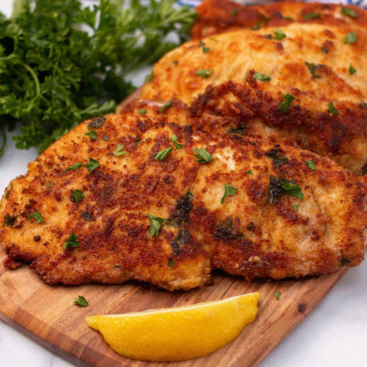 Close up of Italian chicken cutlets.